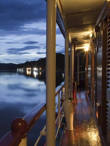 River cruise ship RV River Kwai (Cruise Asia Ltd.) on River Kwai Noi at dusk